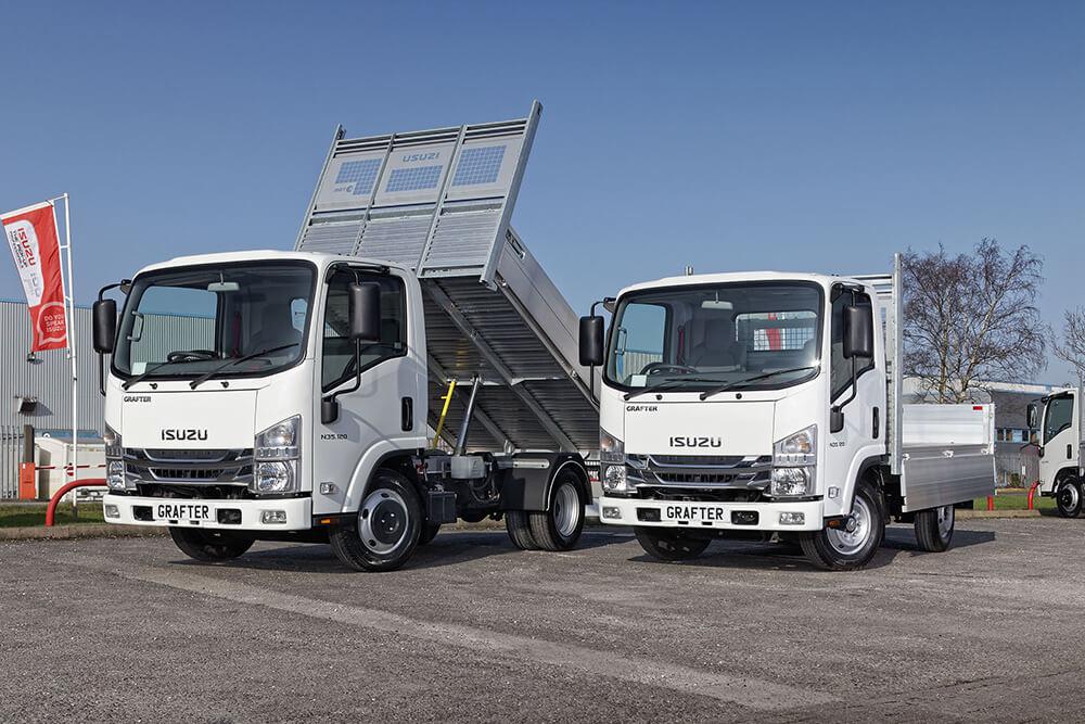 Image of two driveaway Isuzu trucks: the twin rear wheel N35.120 tipper and the single rear wheel N35.120 dropsider