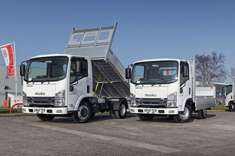 Image of two driveaway Isuzu trucks: the twin rear wheel N35.120 tipper and the single rear wheel N35.120 dropsider