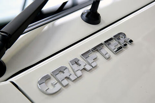 Image of an Isuzu Grafter chrome badge